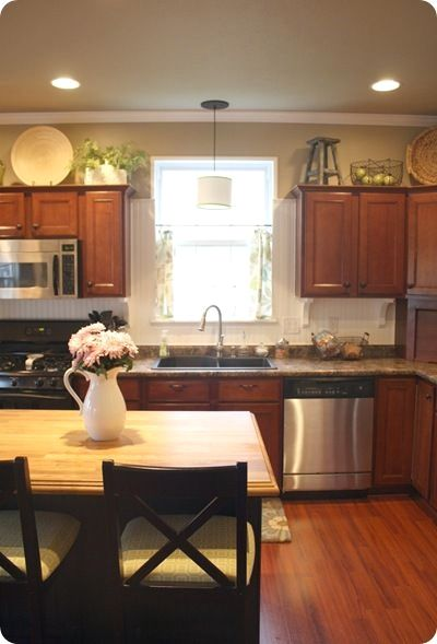 Tips on how to decorate the empty space above your kitchen ...