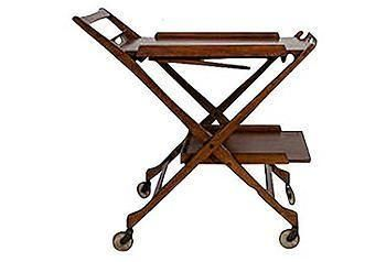 A beautiful wood midcentury folding bar cart.