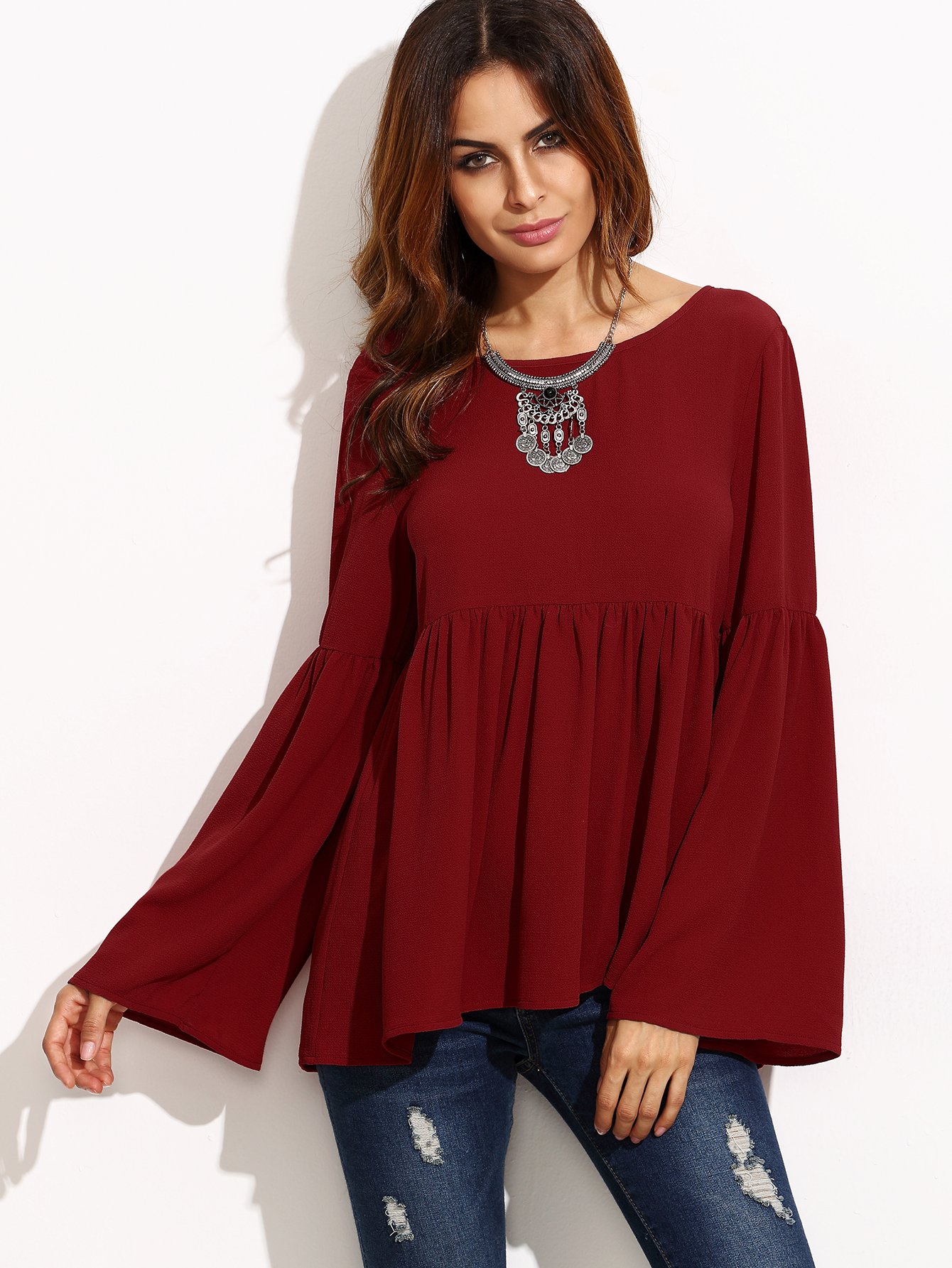 SheIn offers Burgundy Bell Sleeve Cutout Back Babydoll Blouse   more to fit  your fashionable needs. 6b5d421de