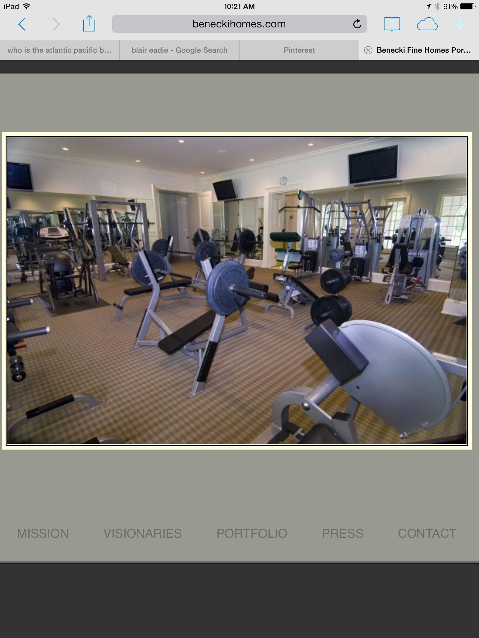 Basement gym idea canned lights tvs above mirrors basement gym