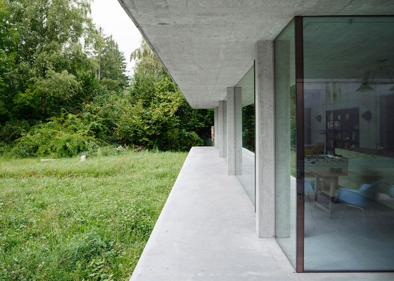 Concrete Slabs Frame Glass Walls Of Swiss House By Mlzd Concrete House Architecture Concrete Houses