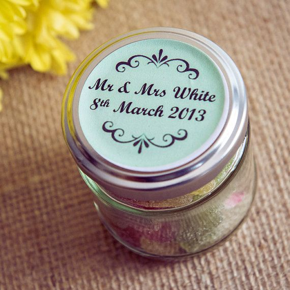 Personalised wedding favour jar decorated with a customised sticker