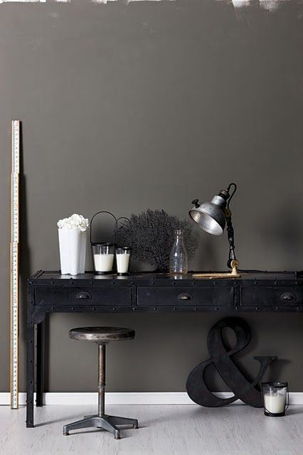 grey wall and black desk: Photo by Craig Wall | Industrial