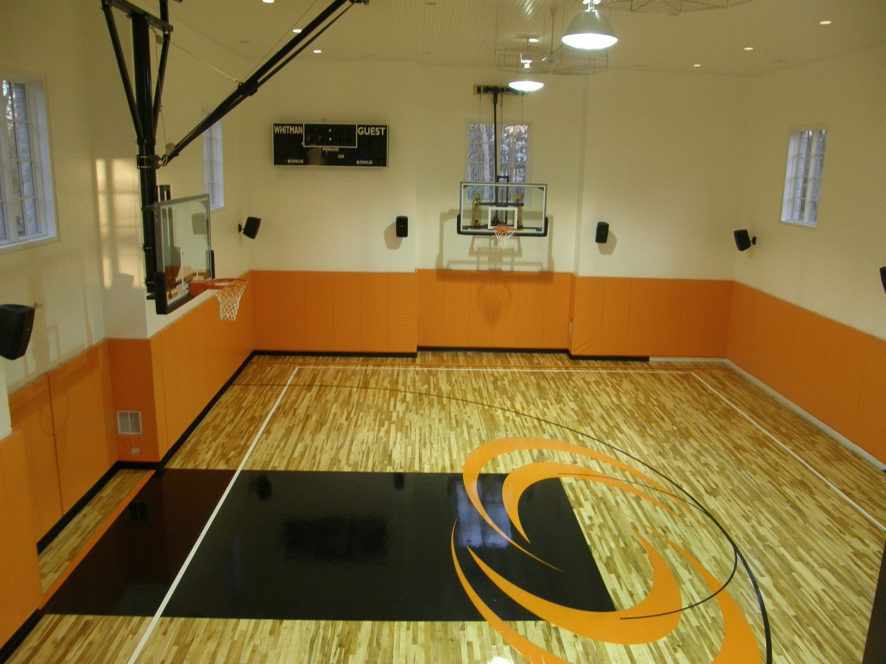 Orange black basketball court indoor residential for Indoor basketball court plans