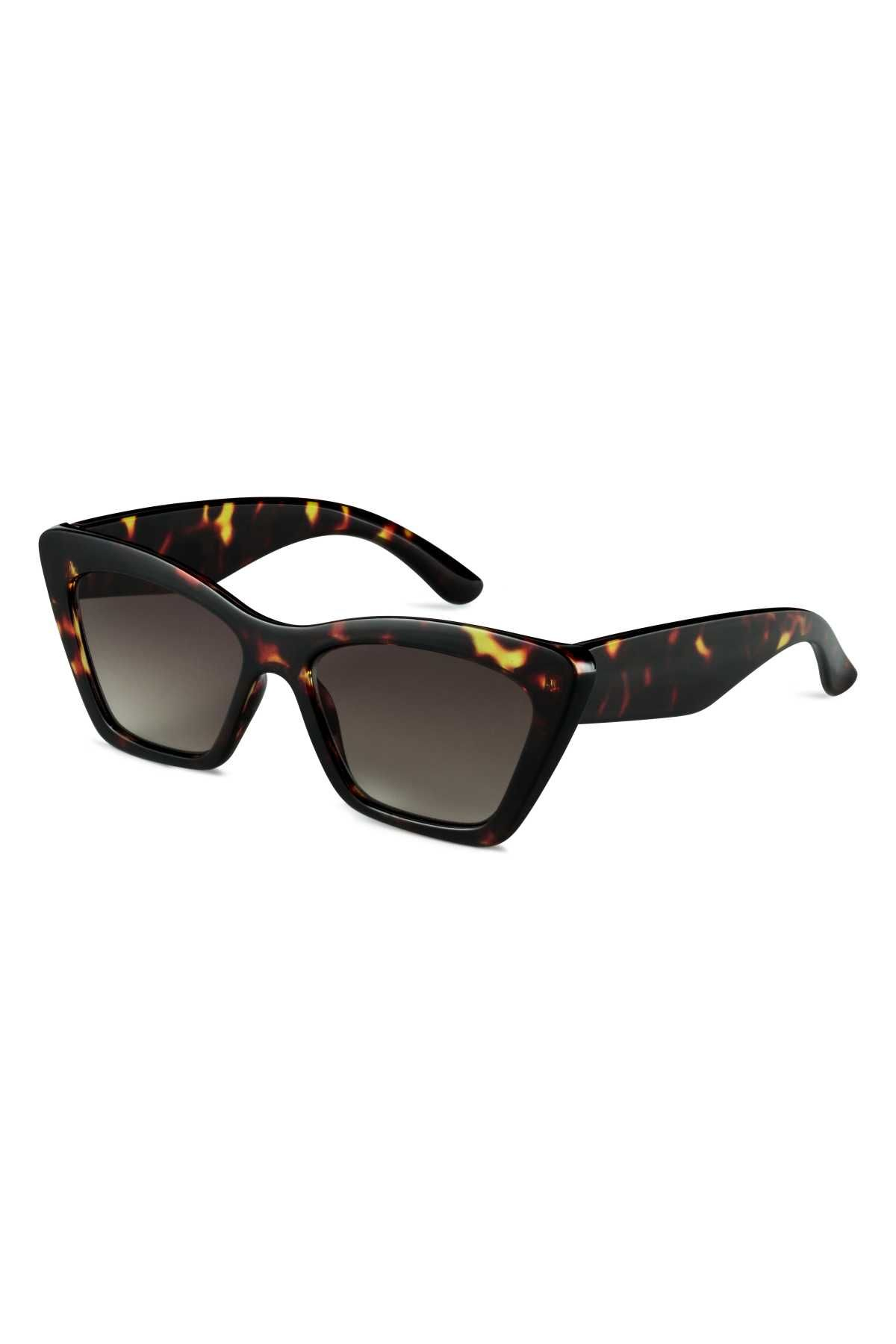 2d8faef5a3fbf Dark brown tortoiseshell. Sunglasses with plastic frames and UV-protective