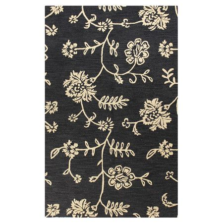Showcasing a scrolling floral motif on a black background, this hand-tufted wool rug brings a pop of pattern to your dining room or den.   ...