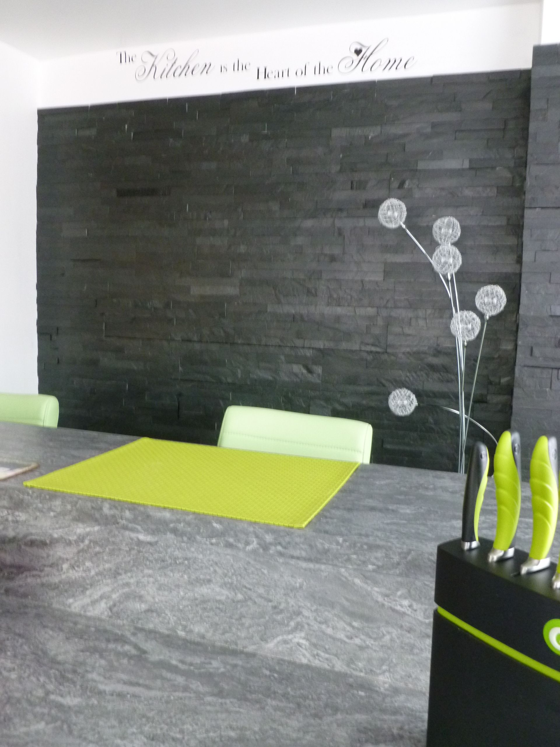 Feature wall behind this kitchen breakfast bar featuring split
