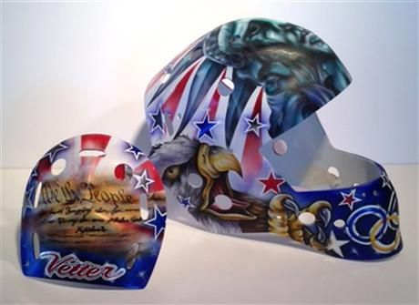 Jesse Vitter's original design on her goalie helmet for the 2014 Olympics. The preamble was removed from the back of it because of rules. Design by: Ron Slater @ Goal Magazine