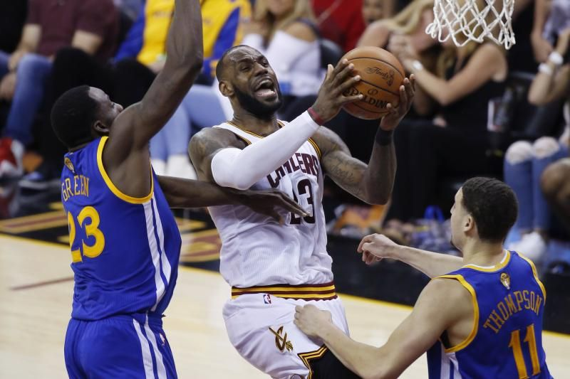 Cleveland Cavaliers Forward Lebron James 23 Drives On Golden State Warriors Forward Draymond Green 23 And Klay Tho Nba Finals 2017 Nba Finals Warriors Game