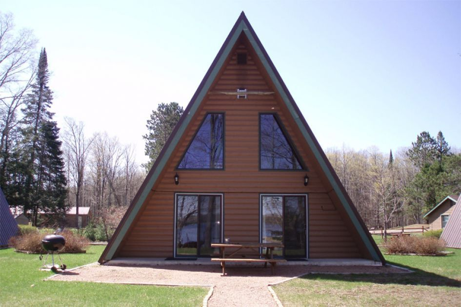 A-frame roof.This rustic-style triangular cabin sits next to a ...