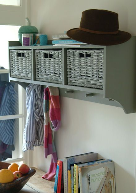 Grey wooden hallway shelf, wicker baskets and five coat hooks. Great idea  and looks