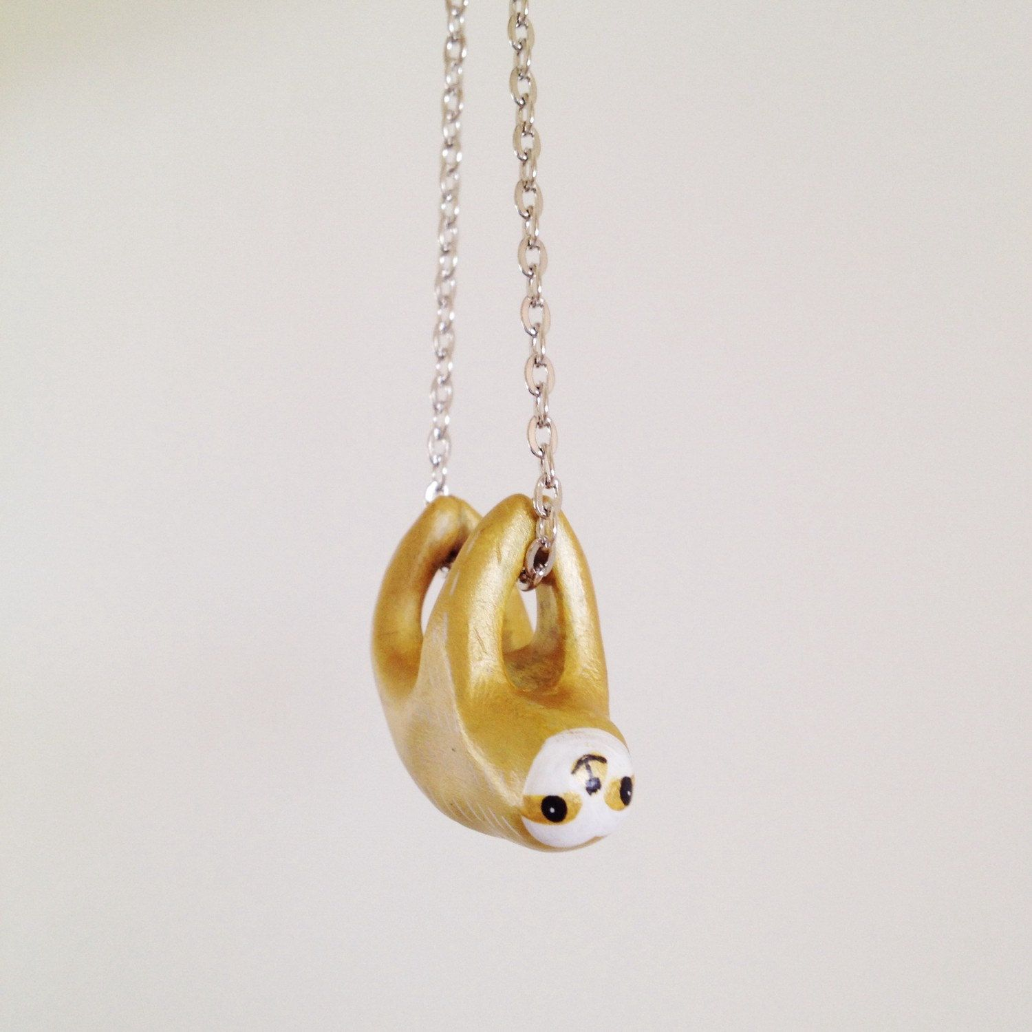product necklace plated cast sloth pendant out gold products image social