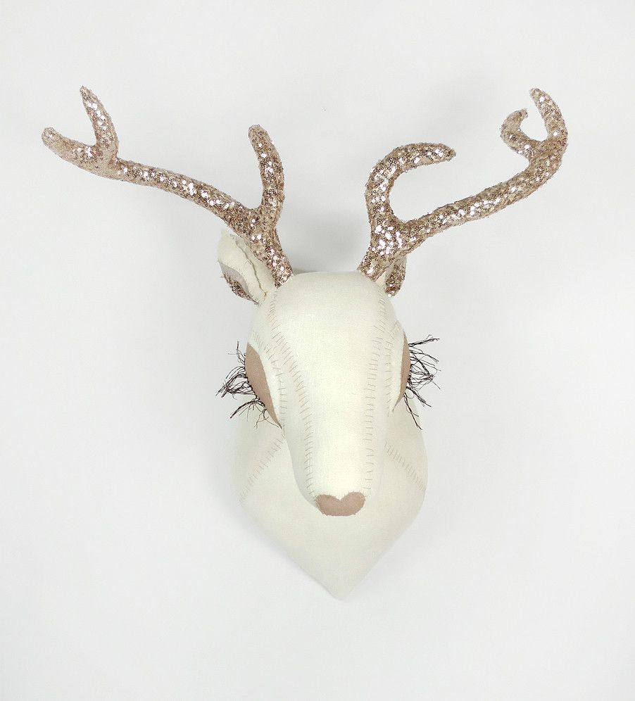 Deer Head: White with dusty pink/goldish Antlers