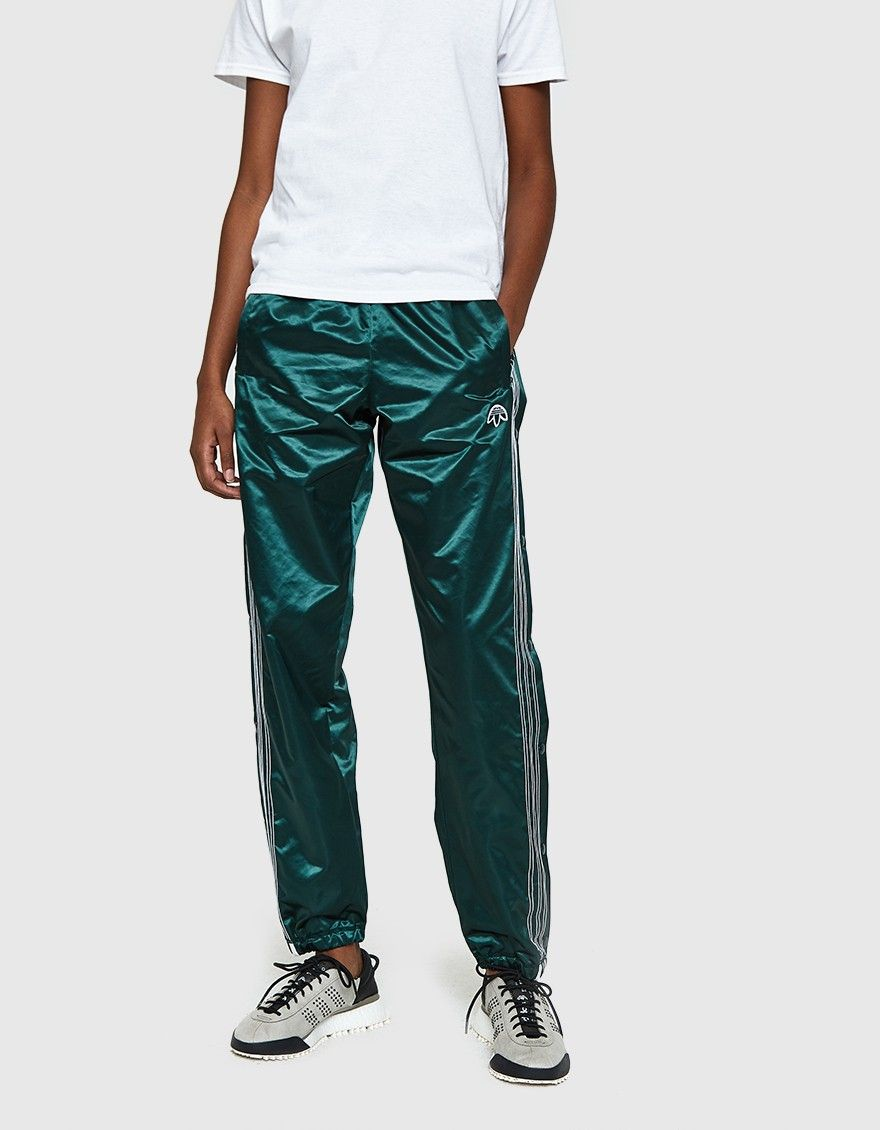 7df3464b6d5894 Track pants from Adidas in collaboration with Alexander Wang in Green  Night. Elastic waistband. Front vertical zip pockets.