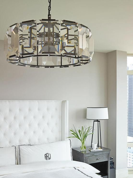 chic elegant bedroom features a restoration hardware harlow crystal chandelier hanging over a