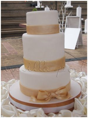 A simple 3 tier fondant wedding cake with a taller 2nd tier
