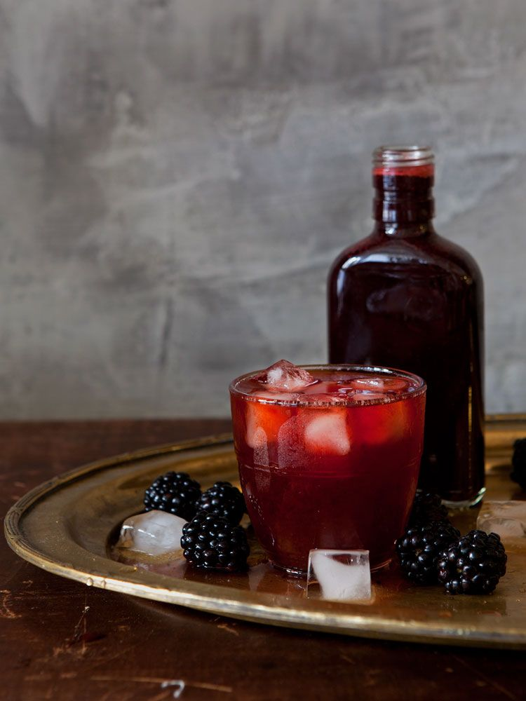 Shrub, the sweet-tart syrup favored by colonial Americans, is simply made by macerating fruit in sugar until the fruit exudes its juice, straining, then adding vinegar. Mixed with rum and soda, it makes a bracing drink, ideal for summer afternoons.  This recipe was shared with us by Stacey Harwood in her article Late Summer Fruits With Wines and Spirits.
