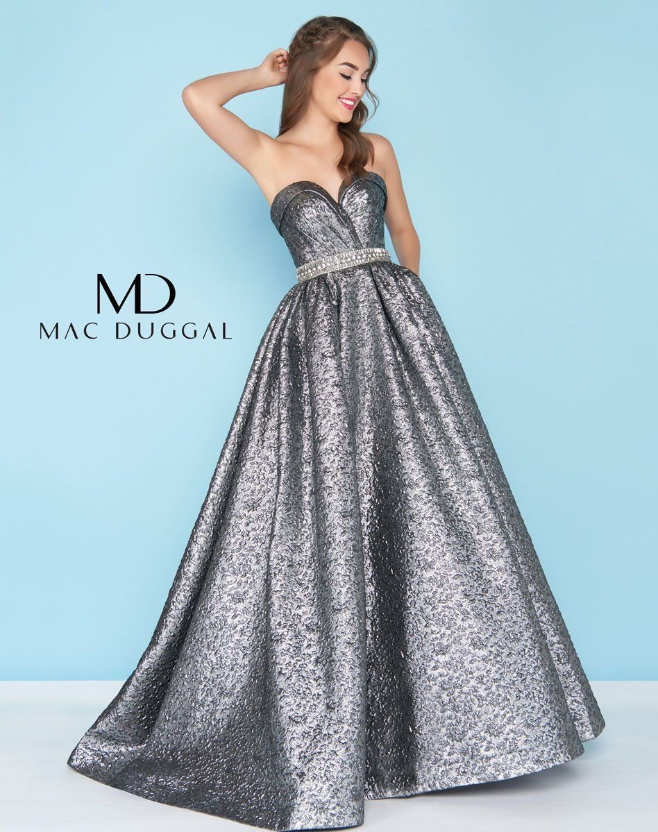 9fde384fc5 Mac Duggal prom dress. Dare to be different in the metallic embossed  brocade accented with a strapless neckline