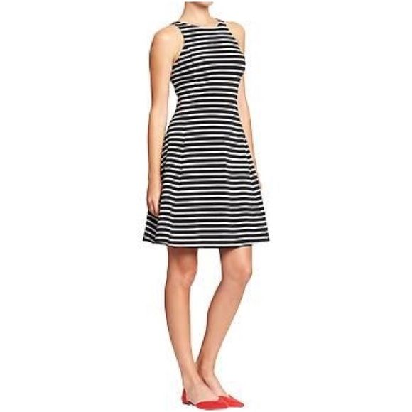 """Old Navy Striped Fit and Flair Dress Old Navy Black and White Stripe Fit and Flare Dress  96% cotton 4% spandex. Super cute and trendy! 36"""" shoulder to hem 16"""" armpit to armpit. I'm 5'6"""" and it hits right at my knee.  Great used condition. Old Navy Dresses Midi"""