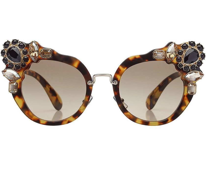 5f52b99a07d5 MIU MIU Embellished Cat-Eye Sunglasses. Crowned with elegant black and  white stones