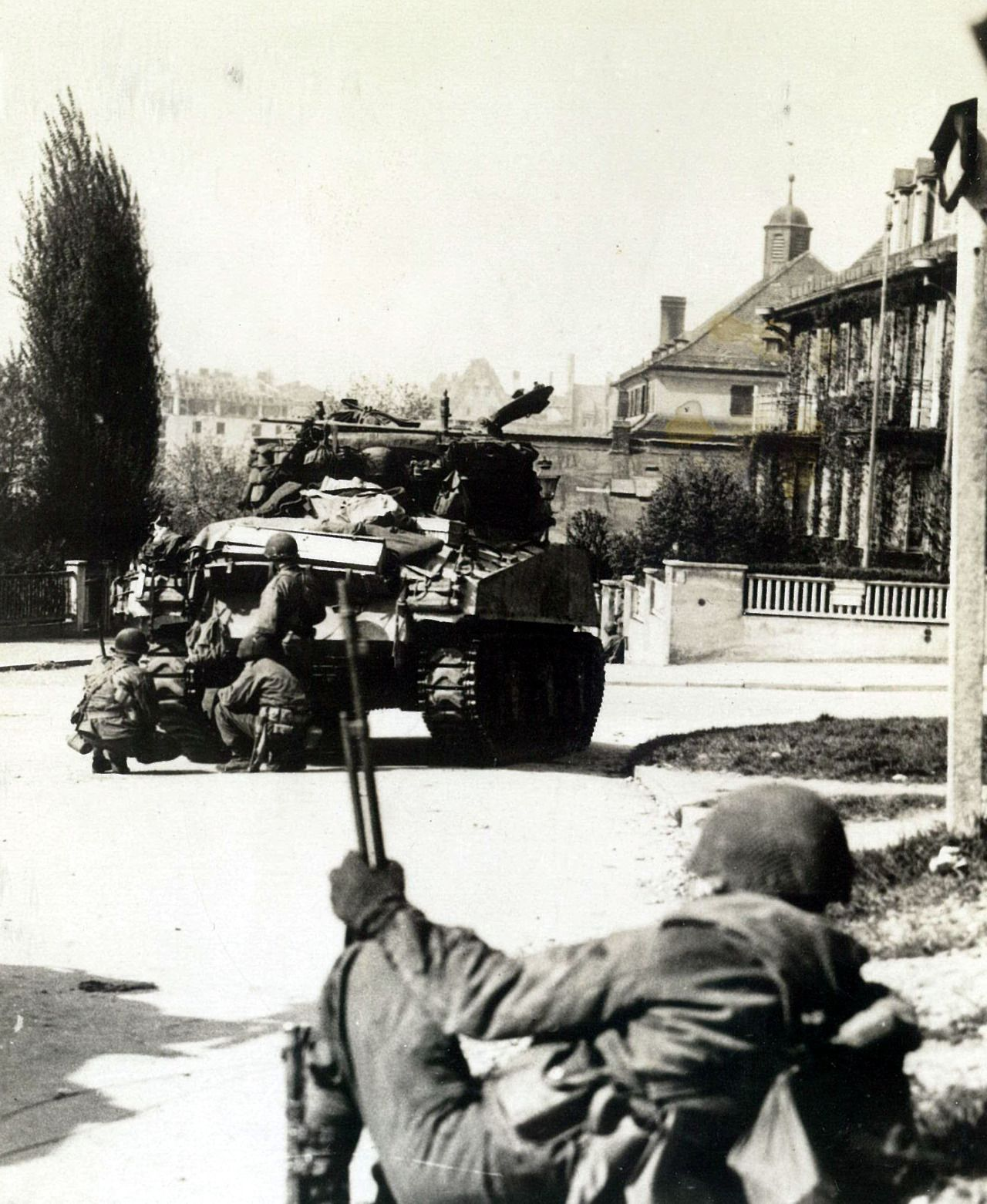 Using an M4 Sherman as cover, Nuernberg 1945 ~