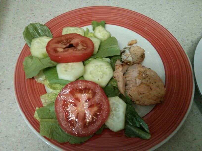 Summer salad cucumbers &  tomatoes and lite dressing with grilled salmon
