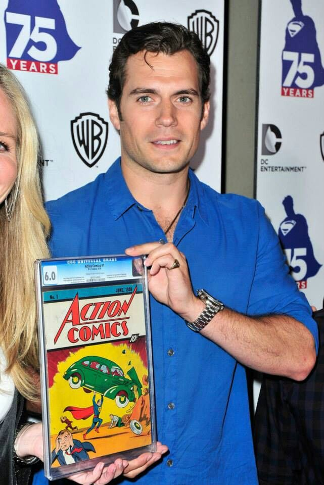 Superman/Henry Cavill posing with first Superman comic / San Diego Comic Con 2013
