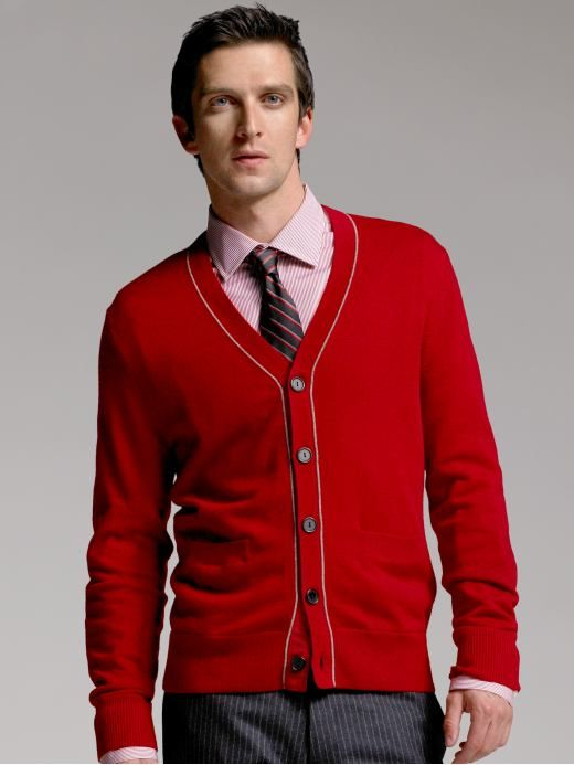 Love the combo of this red cardigan and the striped pants. mmm ...