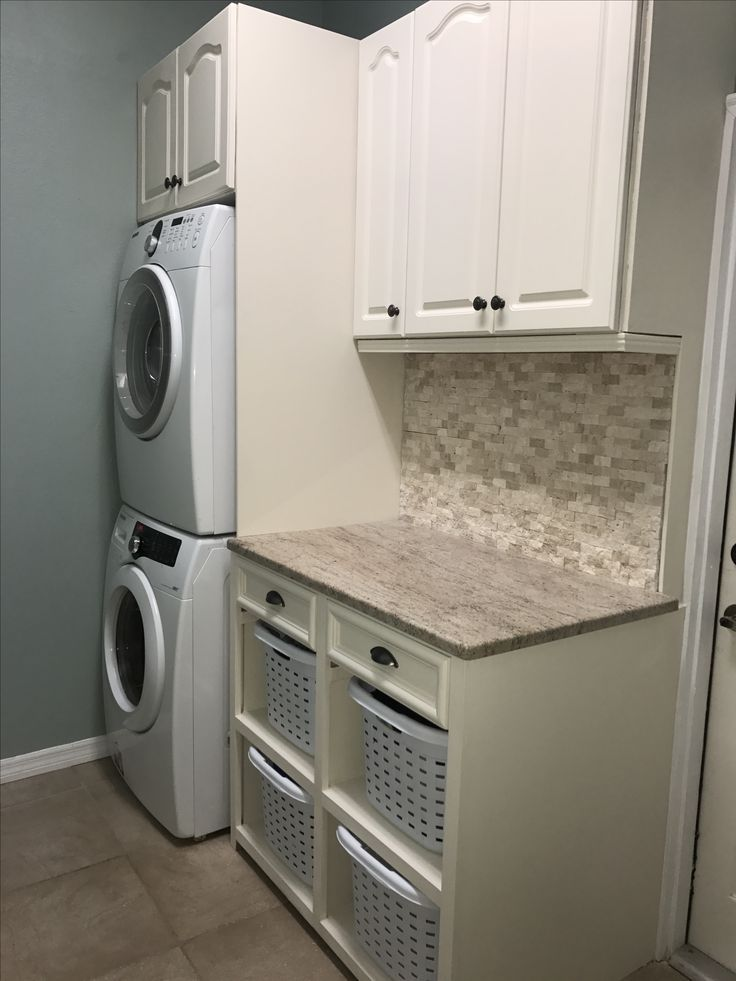 Stacked Washer And Dryer, Storage Cabinets, And
