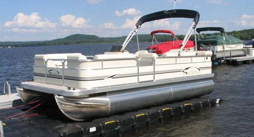 A drive on boat lift makes it safe for all passengers to for Boat garage on water