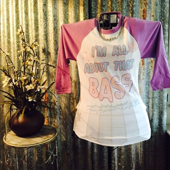 "sale ""I'm All About That Bass"" Tshirt SZ XS Super cute Tshirt with light purple sleeves that says ""I'm All About That Bass"". Top is NWT and would look great with jeans. Thanks for looking. ❤️❤️❤️ Tops"