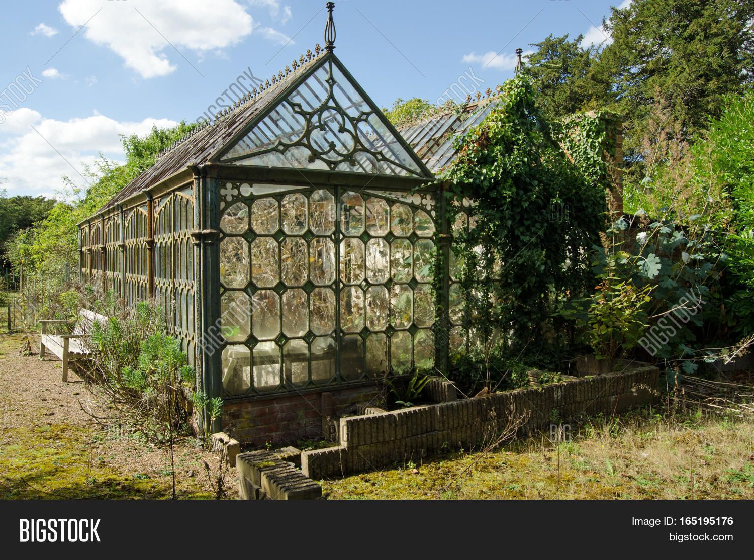 View Of An Old Victorian Cast Iron Greenhouse In An Un Loved State