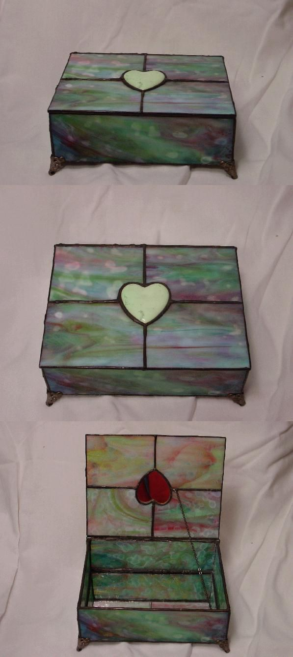 Stained Glass Box made with Bullseye glass and accented with a hand finished Chrysoprase heart.  The inside of the bottom of the box is set with regular mirror.