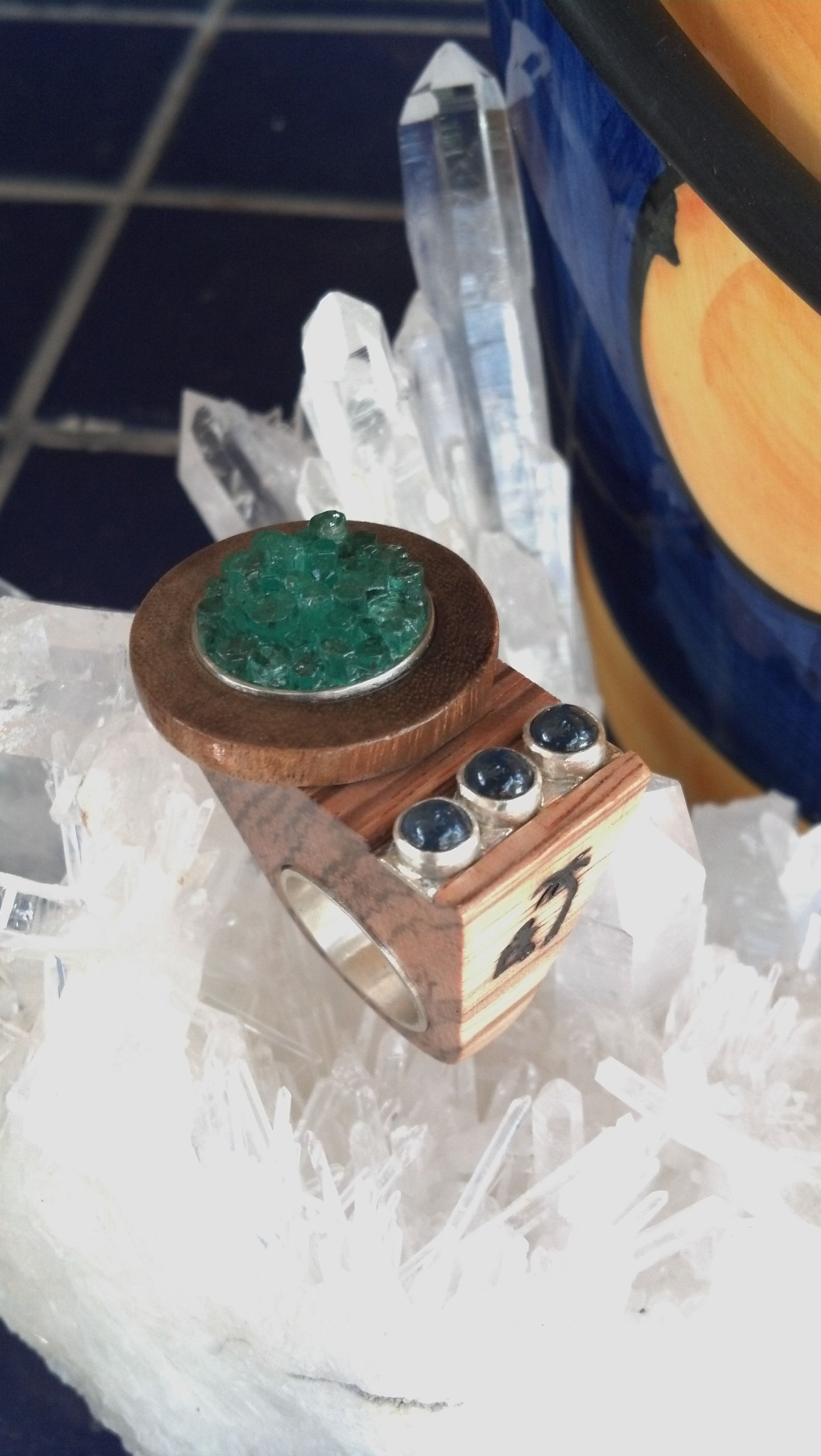 Beautiful wood, silver, emeralds and sapphires...just different...