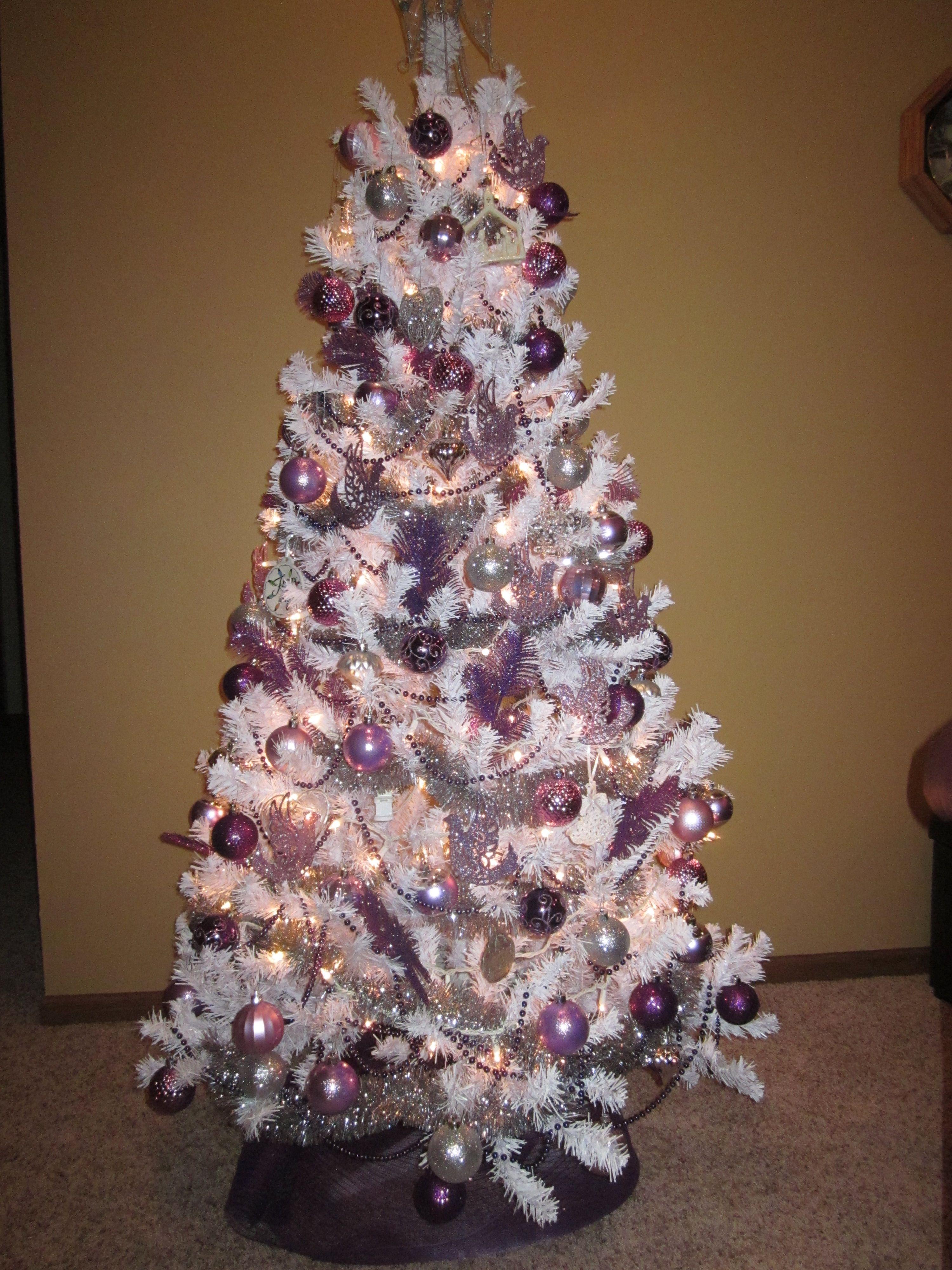 White tree silver tinsel garland purple beads