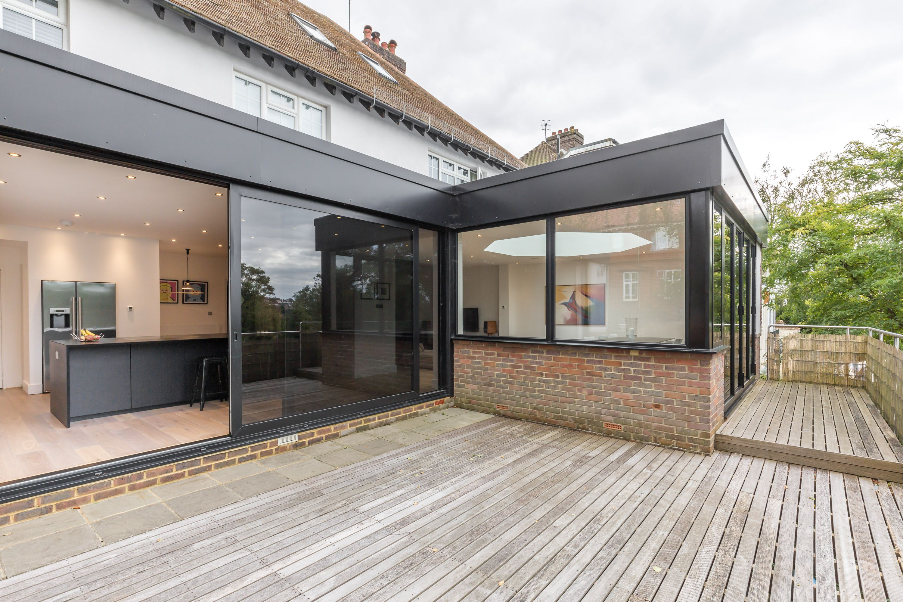Contemporary flat roof rear extension to detached brighton Contemporary flat roof designs