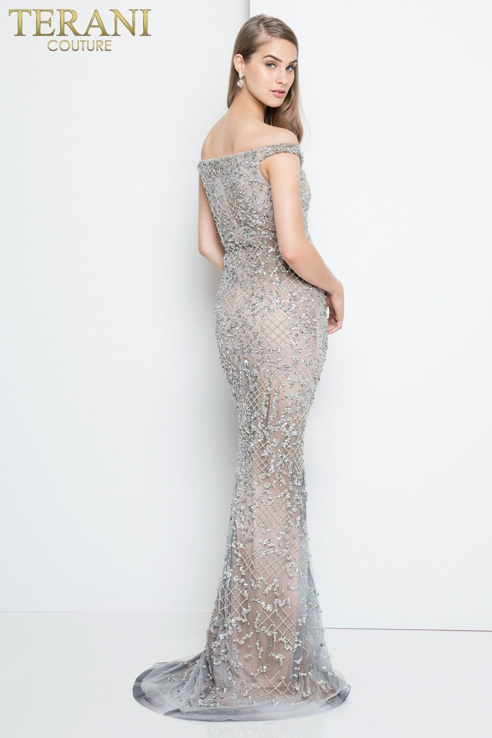 b6dd8f949f0 This Terani 1811P5261 evening gown is embellished with crystals throughout  the gown with off the shoulder sleeves and a high slit. AVAILABLE FOR PRE  ORDER  ...