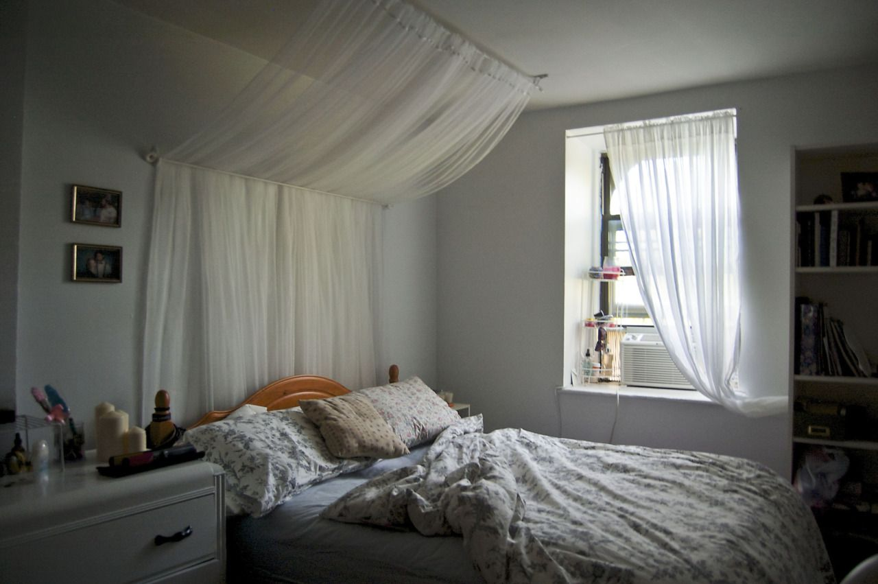 White bedroom in brooklyn new york canopy over the bed is for Canopy over bed