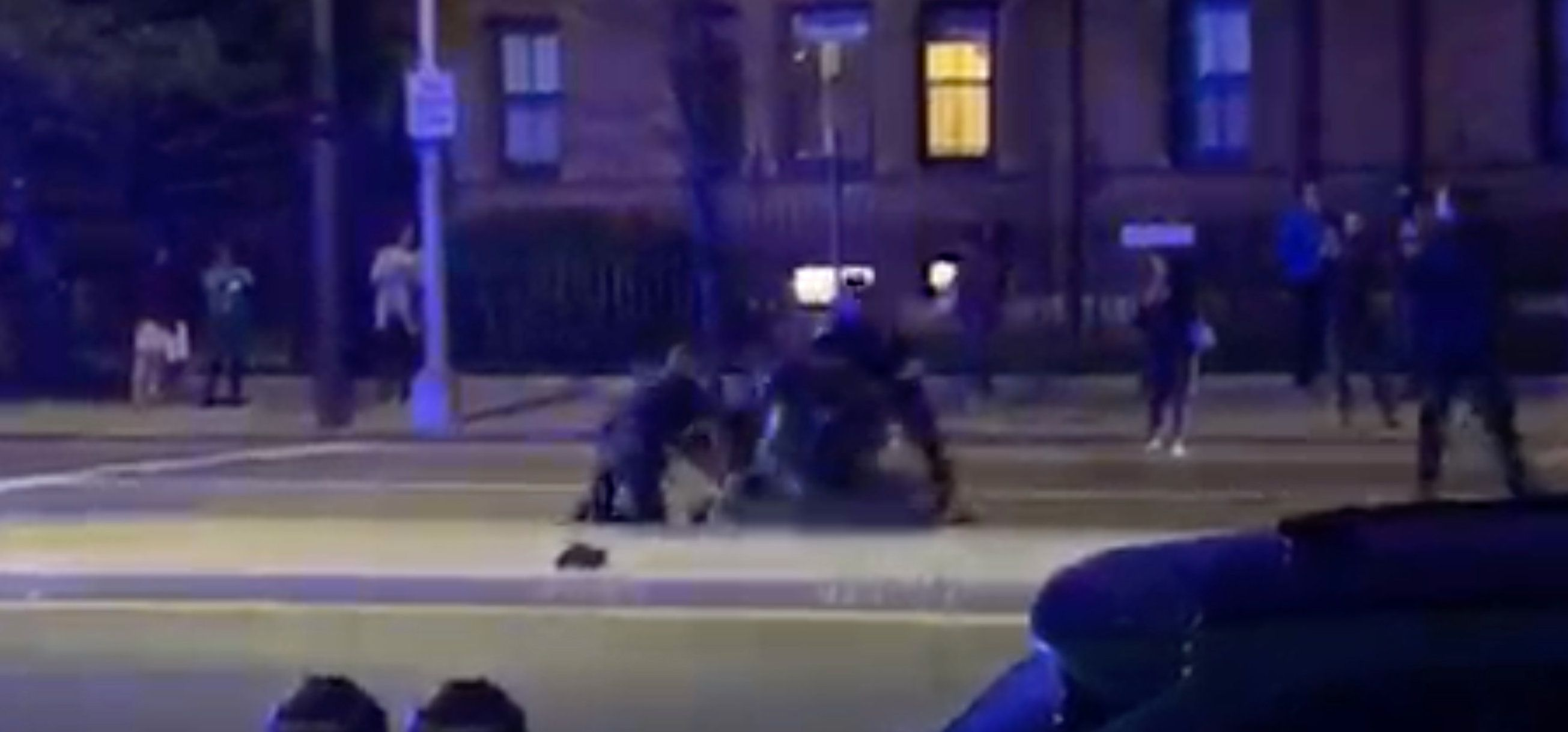 Video of a black Harvard student being punched by