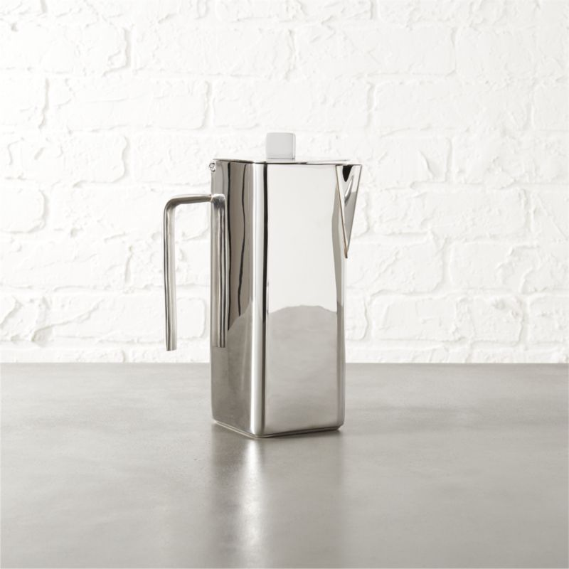 Shop vienna stainless steel coffee pot.   Sleek, stainless steel coffee pot nods to the retro Viennese café tradition.  Hinged-lid server fits perfectly in matching lightweight tray, stepping up your home-entertaining game.