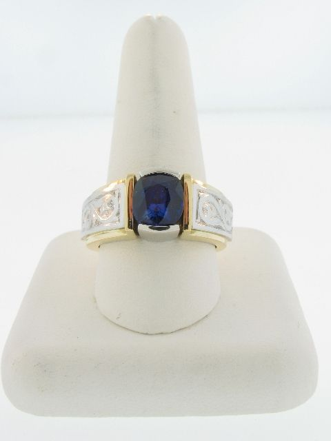 Entry 204  Gordon D. Aatlo  Gordon Aatlo Designs  San Carlos, CA  18K yellow gold and platinum ring featuring a 3.68 ct. cushion-cut blue Sapphire