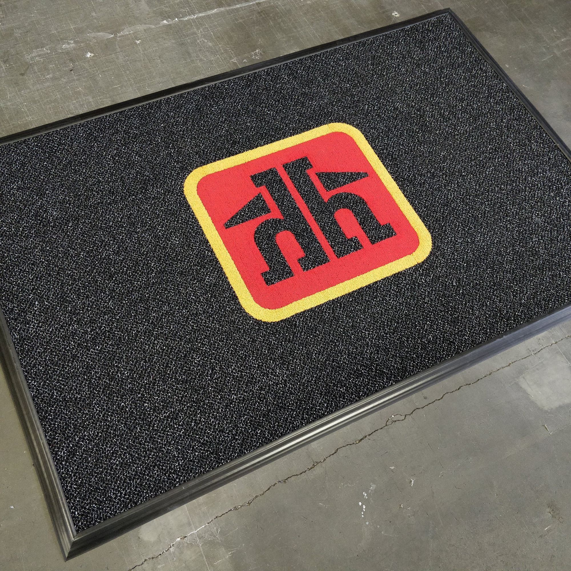 This custom inlaid logo mat features our Duromat spaghetti