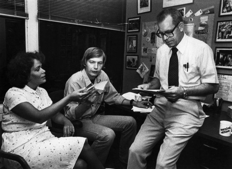 Jackie Judd, Bob Edwards and Carl Kasell discuss news coverage in this photo taken in the late 1970s.