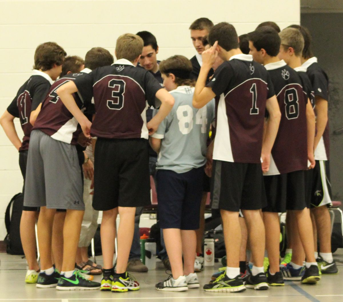 The Jb Boys Vollyball Team Are Having A Team Huddle Varsity Jacket Sports Sports Jersey