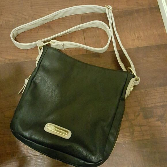 Steve Madden cross body purse This is real leather. The bottom unzips to add more room. This is in very good condition. The leather cream buckle strap on the back pocket has a slight rubbing from my jeans. The only other wear is inside and the metal pieces. I kept leather cleaner on this, so it looks fabulous. Steve Madden Bags Crossbody Bags