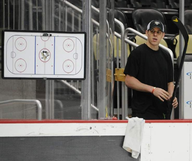 Wearing protective gear, Crosby resumes skating for Penguins ...