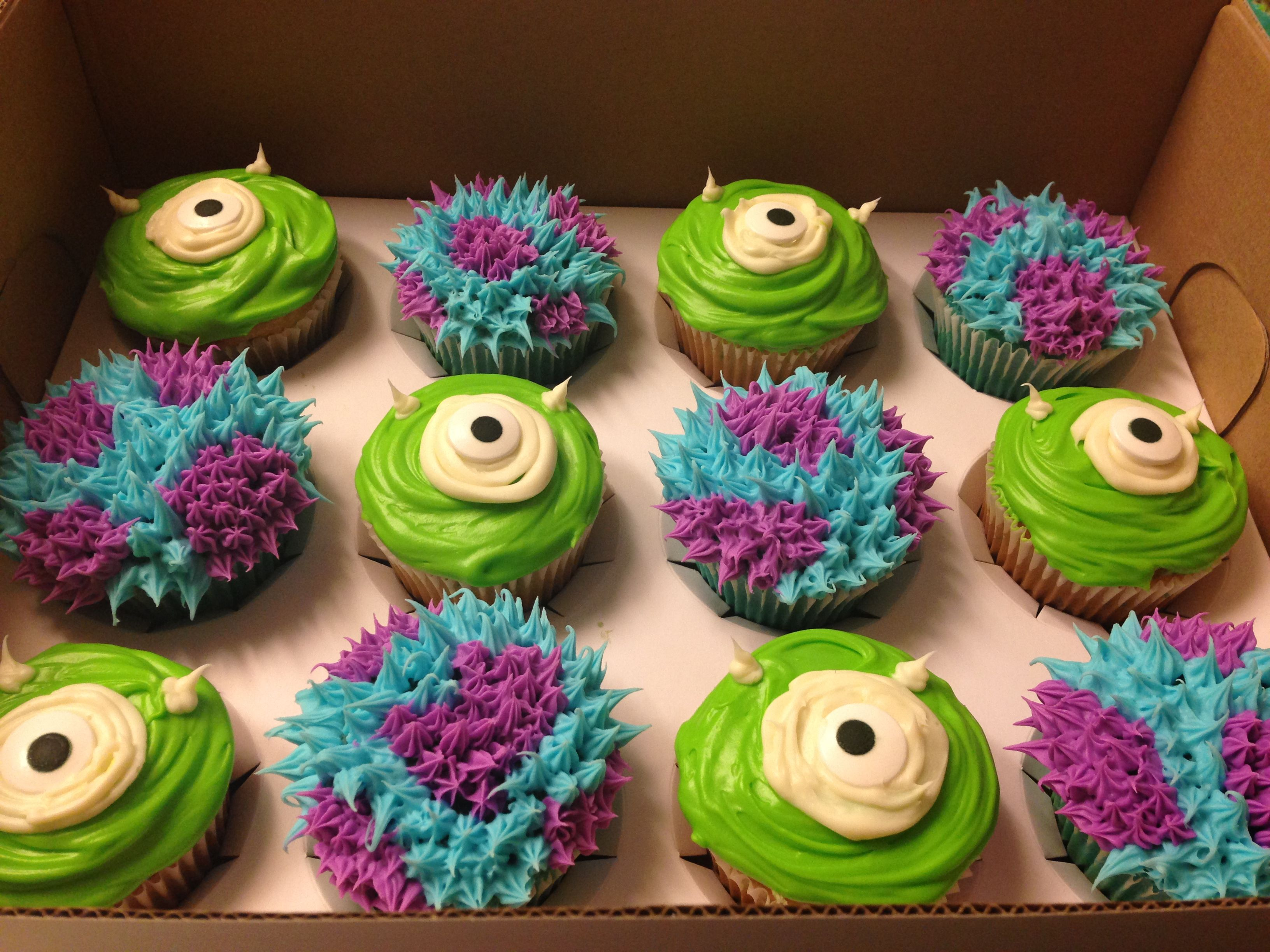 My attempt at these Monsters Inc. Cupcakes. I just made them the 'ol Pillsbury and Sara Lee way. Sully ones are blue velvet cake with blue raspberry and purple vanilla frosting. Mike ones are white cake with green bits in it and key lime frosting. monsters inc monsters incorporated birthday Birthday cupcakes cup cakes