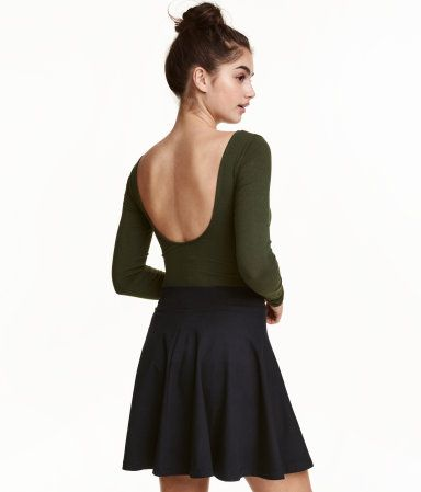 083765de5b Dark green. Long-sleeved jersey bodysuit with a low-cut neckline at back  and snap fasteners at gusset.