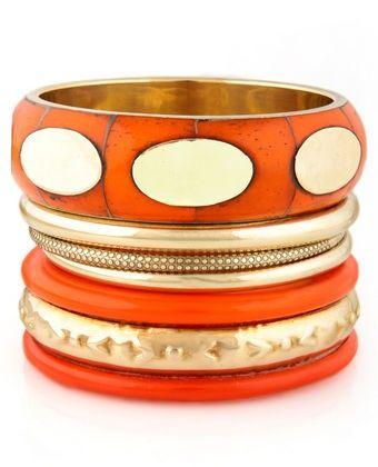 Gold and orange bracelets
