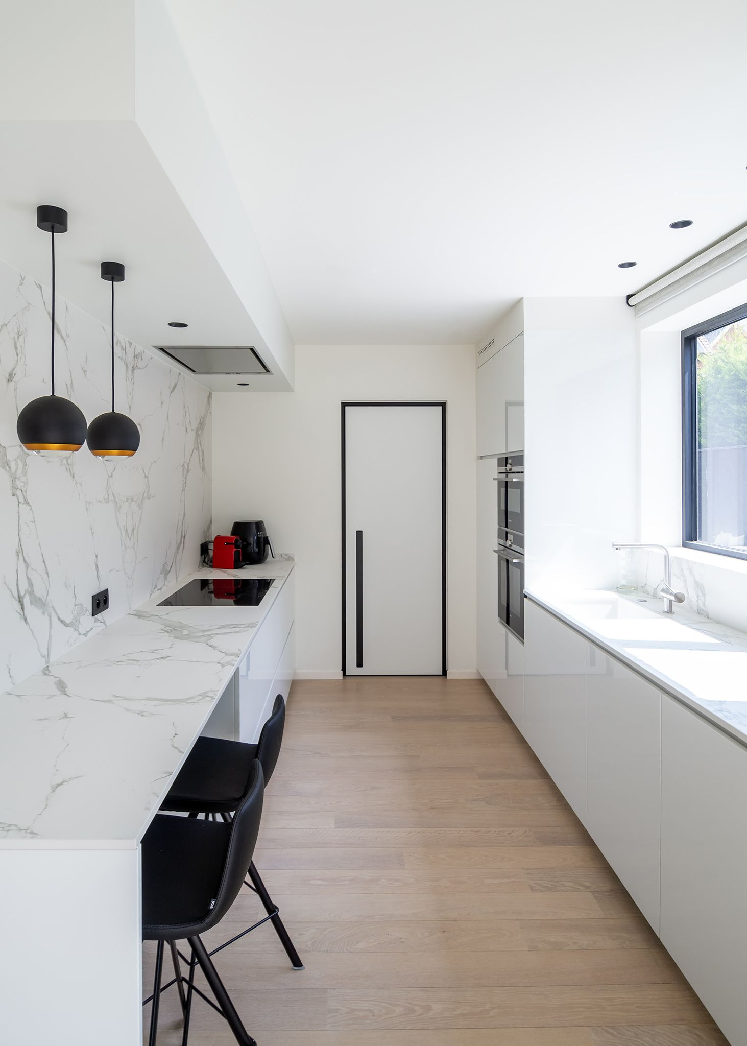 Modern white interior door with a minimal black door frame